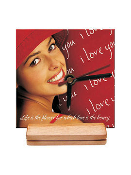 An economical personalised clock with a single wooden stand and hardboard dial of size 6? x 6?.